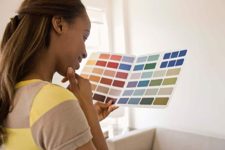 woman choosing paint swatches